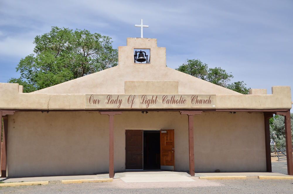 Entrance to the parish in Cubero. The concrete entrance and improved ramp are examples of improved accessibility.