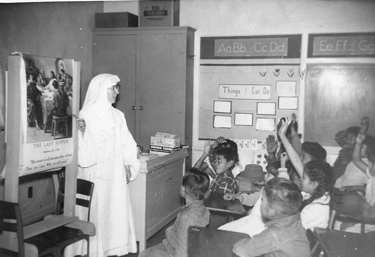A Hospital Sister gives Catechism instruction at the Government school near Lukachukai.