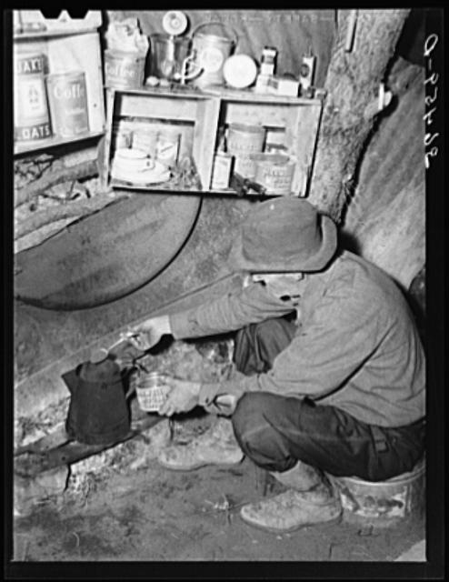 A mine prospector makes coffee in a camp near Grants, NM.