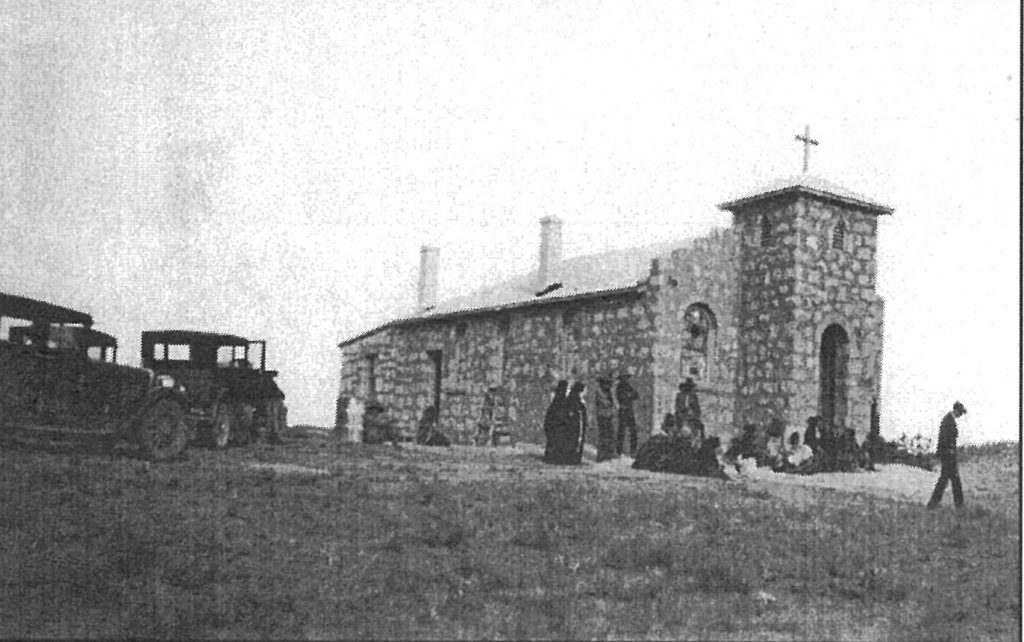 The first church at Houck.