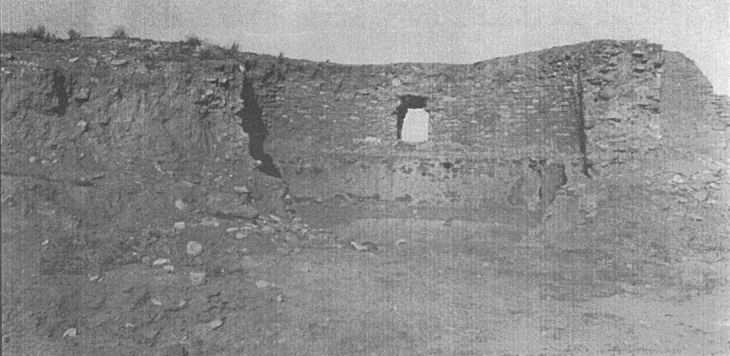Ruins near entrance to mission. This photo was taken just after excavation.