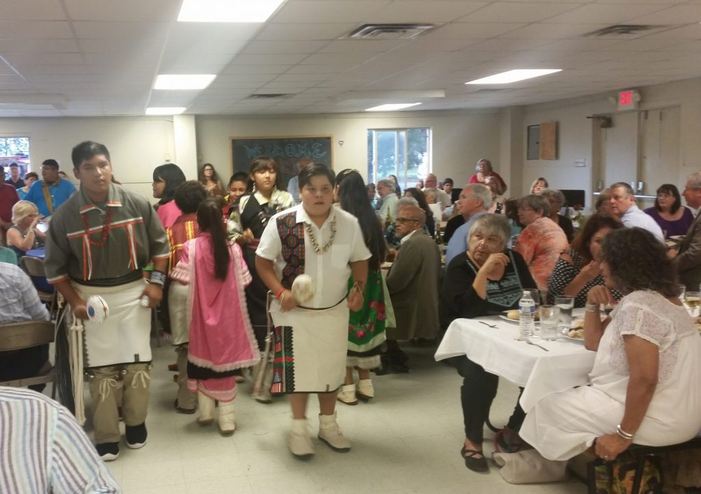 St. Joseph School students perform traditional dances for guests. Photo by Herb Mosher.